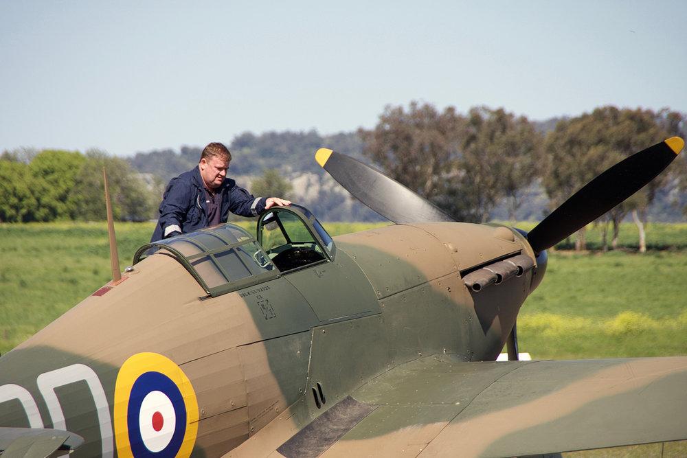 Pilot Ross Pay enters the cockpit