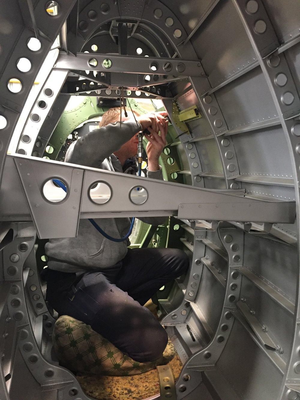 Engineer Sean Fox inside the fuselage