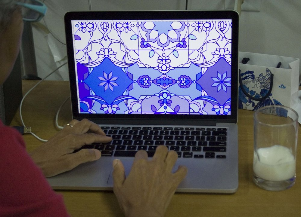 Hend working on an original pattern inspired by Islamic design