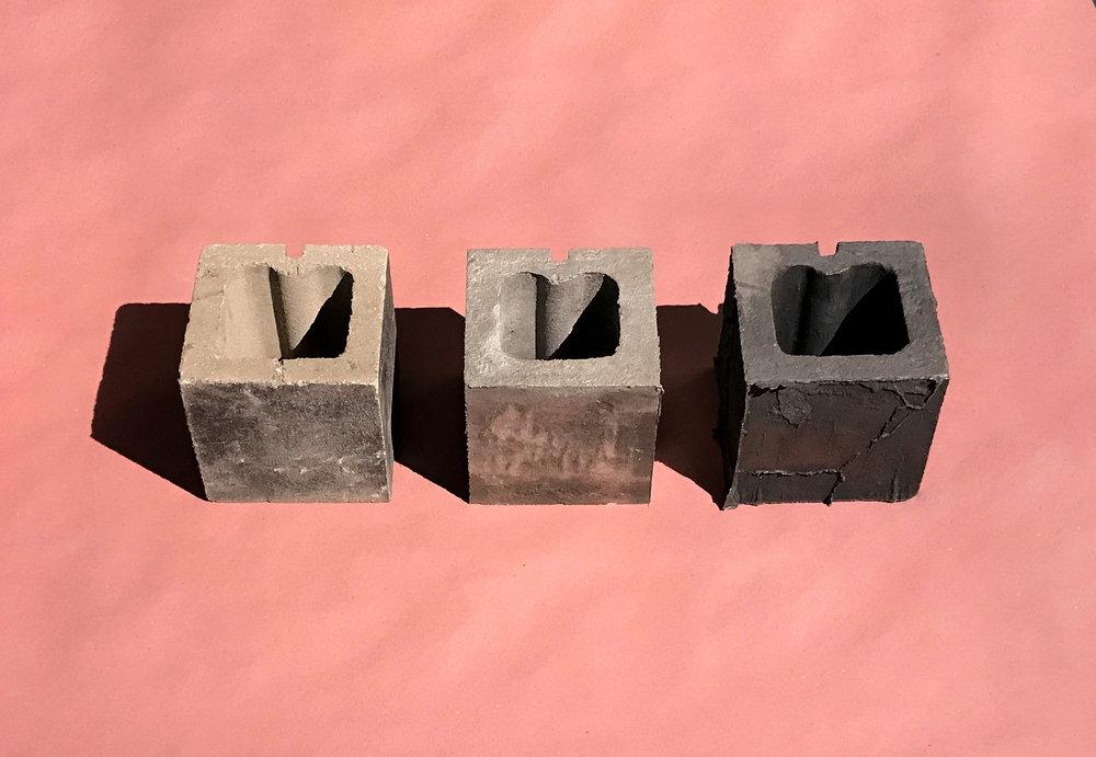 "Block 0: 1-2,  cinder block, cast aluminum cinder block made from single-use sand mold, cast iron cinder block made from same sand mold, 8"" x 8"" x 32"", 2017"