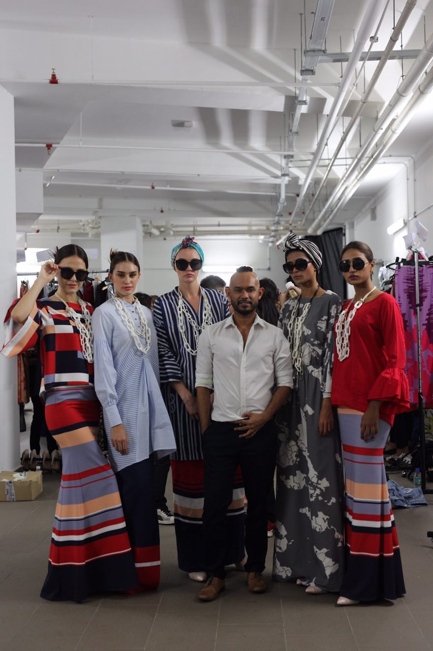 Syomir Izwa with his models backstage