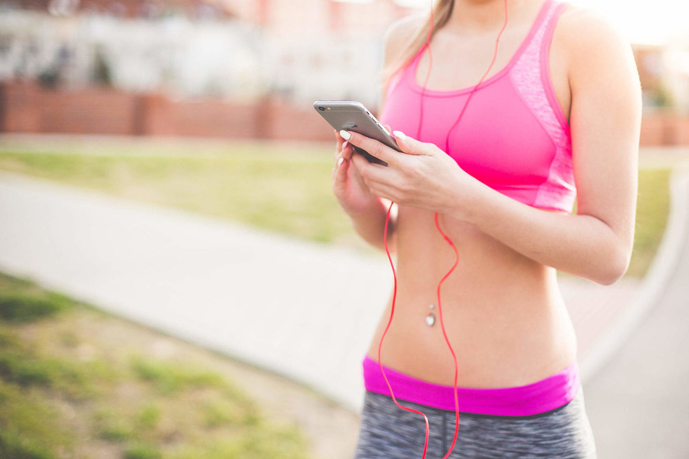 fitness-girl-listening-to-streaming-music-on-her-phone_free_stock_photos_picjumbo_HNCK2000-2210x1474.jpg