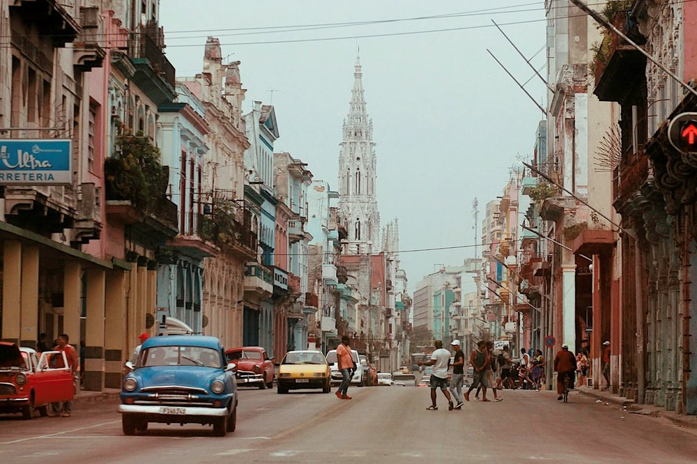 The streets of Cuba lined with vintage cars as documented by Melody Tan on her adventures abroad.