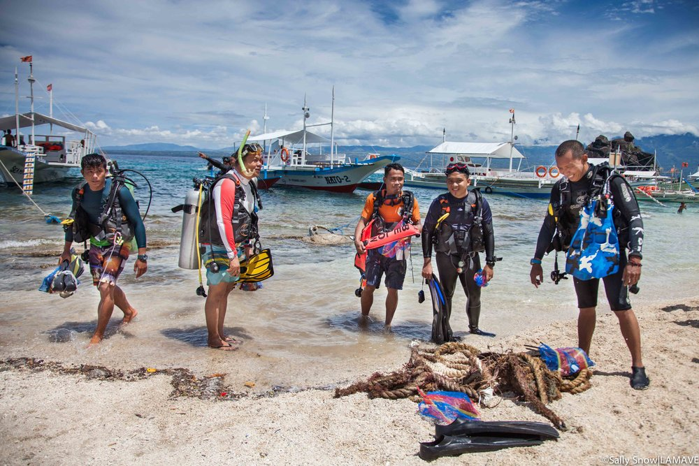 Divers return after a clean up