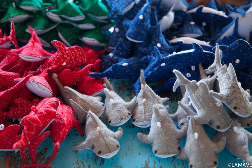 Hand-sewn whale sharks by the Seabreeze womens association.