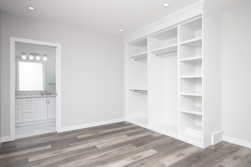 Secondary suite - bedroom and closet.jpg