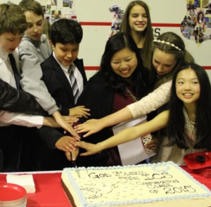confirmation_cutting_cake-300x295.jpeg