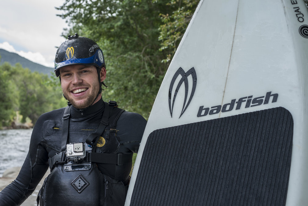 spencer lacy with badfish stand up paddleboard.jpg