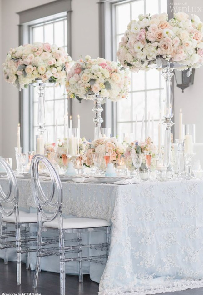 Ghost chairs come in many shapes and styles. This elegant setting includes  chairs with an elaborate back and cushion, for added polish and comfort.