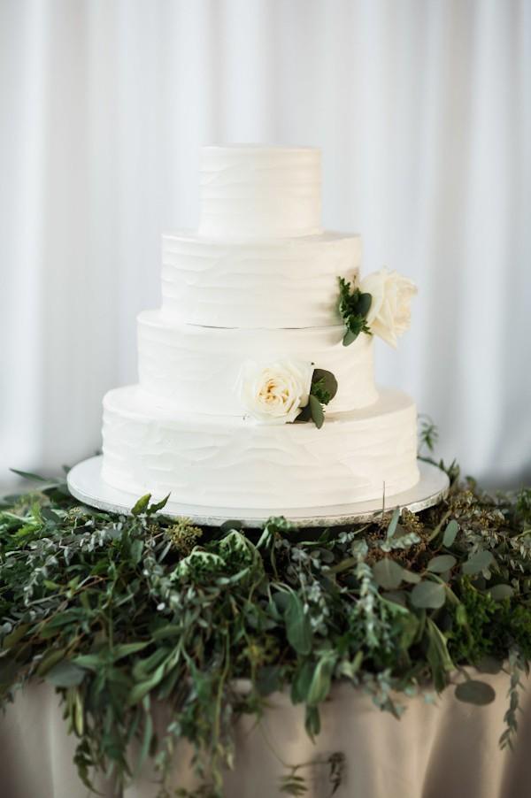 organic-wedding-cake-on-top-of-greenery-3.jpg