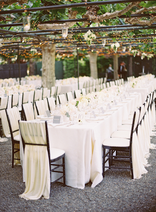 Genial To Soften The Look Of The Venue, These Dark Chairs Are Covered With Simple  White Fabric Woven Between The Backs. They Echo And Continue The Look Of  The ...