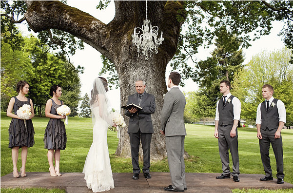 chandelier-hanging-from-tree-wedding.jpg