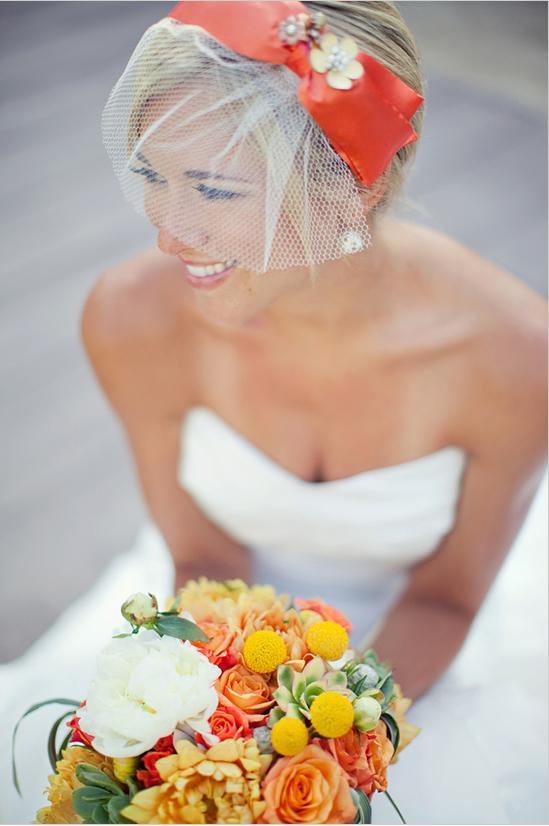 orange headpiece with bouquet