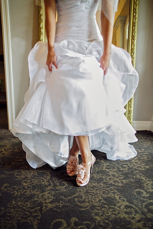 bride in wedding shoes
