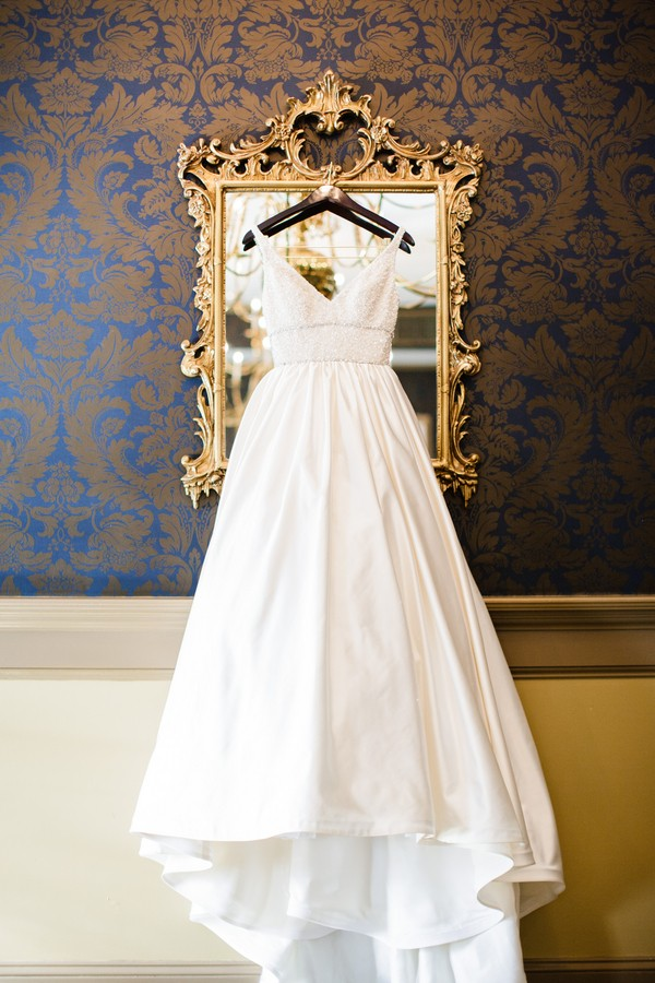 wedding dress hanging from mirror