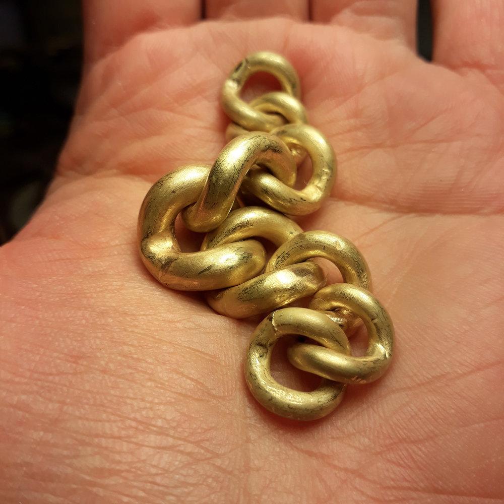 gold links in hand.jpg