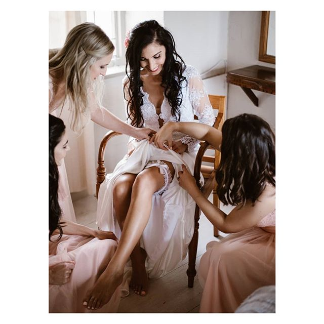 Bride and bridesmaids putting on the garter. . . . #capetown #capetownwedding #capetownweddingphotographer #destinationwedding #destinationweddingphotographer #seanshannonweddings #weddingphotographer #lookslikefilm #firstsandlasts #saweddings #theprettyblog #realwedding #happilyeverafter #love #hoorayweddings #junebugweddings #marthaweddings #weddingconcepts