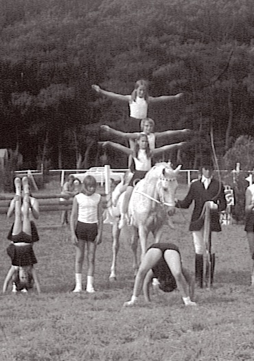 Politz holding horse with vaulting group