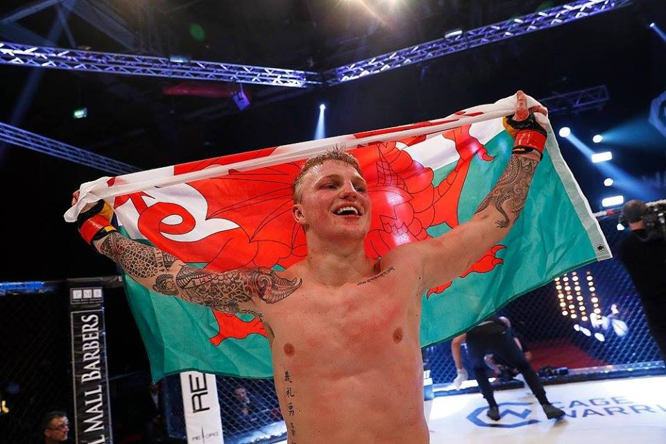 Mason Jones - Mason 'The Dragon' Jones is currently signed to MMA promotion Cage Warriors & sports a perfect 6-0 Professional record.This in addition to a Professional boxing record of 3-0 & an extensive record in Judo (Black Belt) & Brazilian Jiu Jitsu (Brown Belt).In Judo, Mason was a British Cadet Champion & medalled at the Dutch Open u21 & Commonwealth Senior Championships.Mason is fully focused on his MMA career but provides coaching cover where possible to the Cardiff MMA classes & the Newport children's Judo programme.Instagram: masonjones95 Facebook: masonthedragonjones