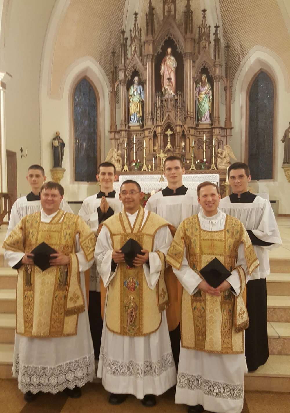 Father Mariano Varela, IVE with diocesan priests for Solemnity of the Sacred Heart at Ss. Peter and Paul in Mankato, Minnesota.