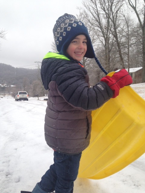 (Wish I had a picture/video of me on the sled but all I've got is one of this cutie. I think he's a good substiture.)