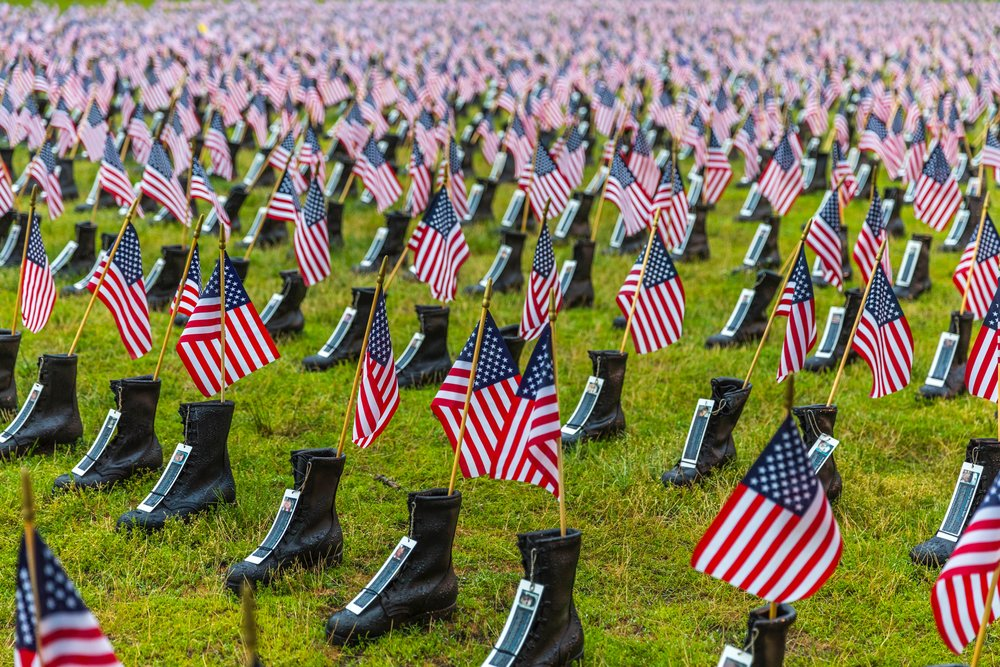Photo of Boots on the Ground for Heroes Memorial in Roger Williams Park, RI, hosted by  Operation Stand Down  Rhode Island. Courtesy of Matthew Huang, 2016.