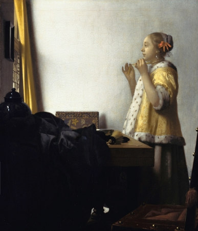 Woman with a Pearl Necklace by Johannes Vermeer. (Little tidbit here, but I did a watercolor rendition of this painting while in art school. It's currently hanging in my guest bathroom.)