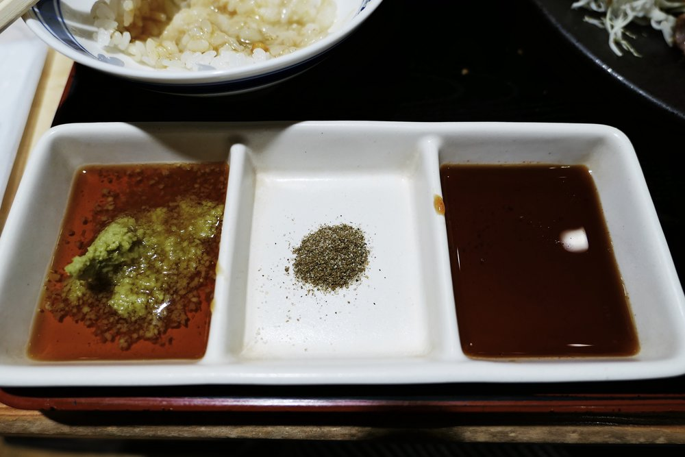 Condiments for dipping. Shoyu with wasabi, their special salt, and a sweeter type of shoyu.