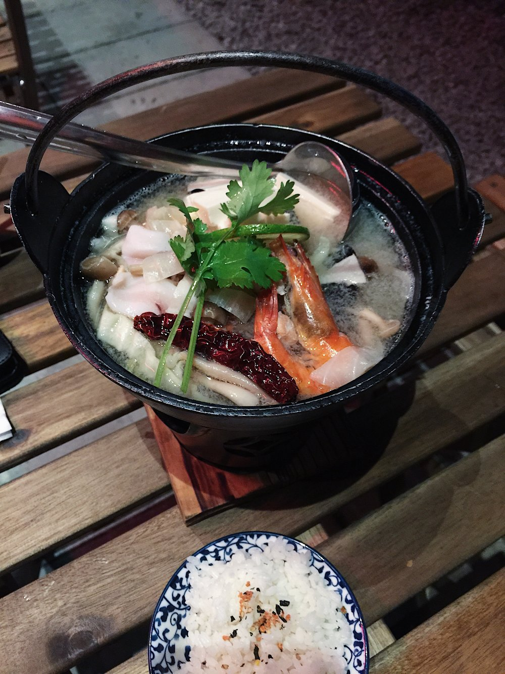 Chankonabe! Their mini verson with a twist of thai .. added lime, dried chilli and lemongrass. . . Seafood Manow Nabe.