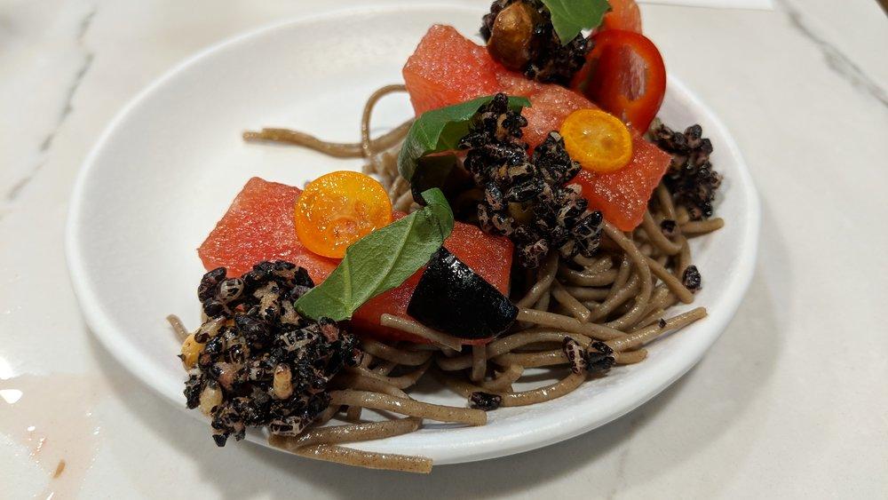 soba noodles, black olives, watermelon, forbidden hazelnut clusters, pickled cumquats, basil