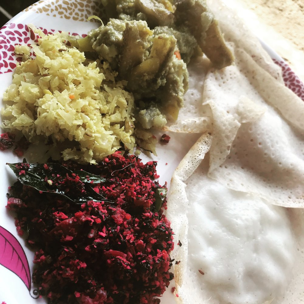 First breakfast: Aupum (fermented rice pancakes, red spinach thoran, cabbage thoran and aviil.