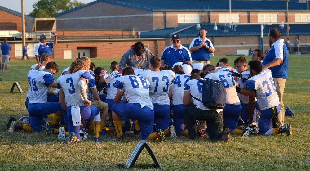 Kneeling football team.jpg