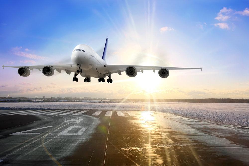 airplane-landing-on-runway-in-airport-m.jpg