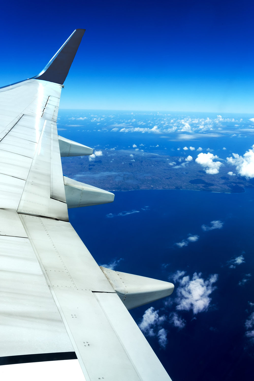 photodune-16050674-aircraft-wing-on-blue-sky-m.jpg