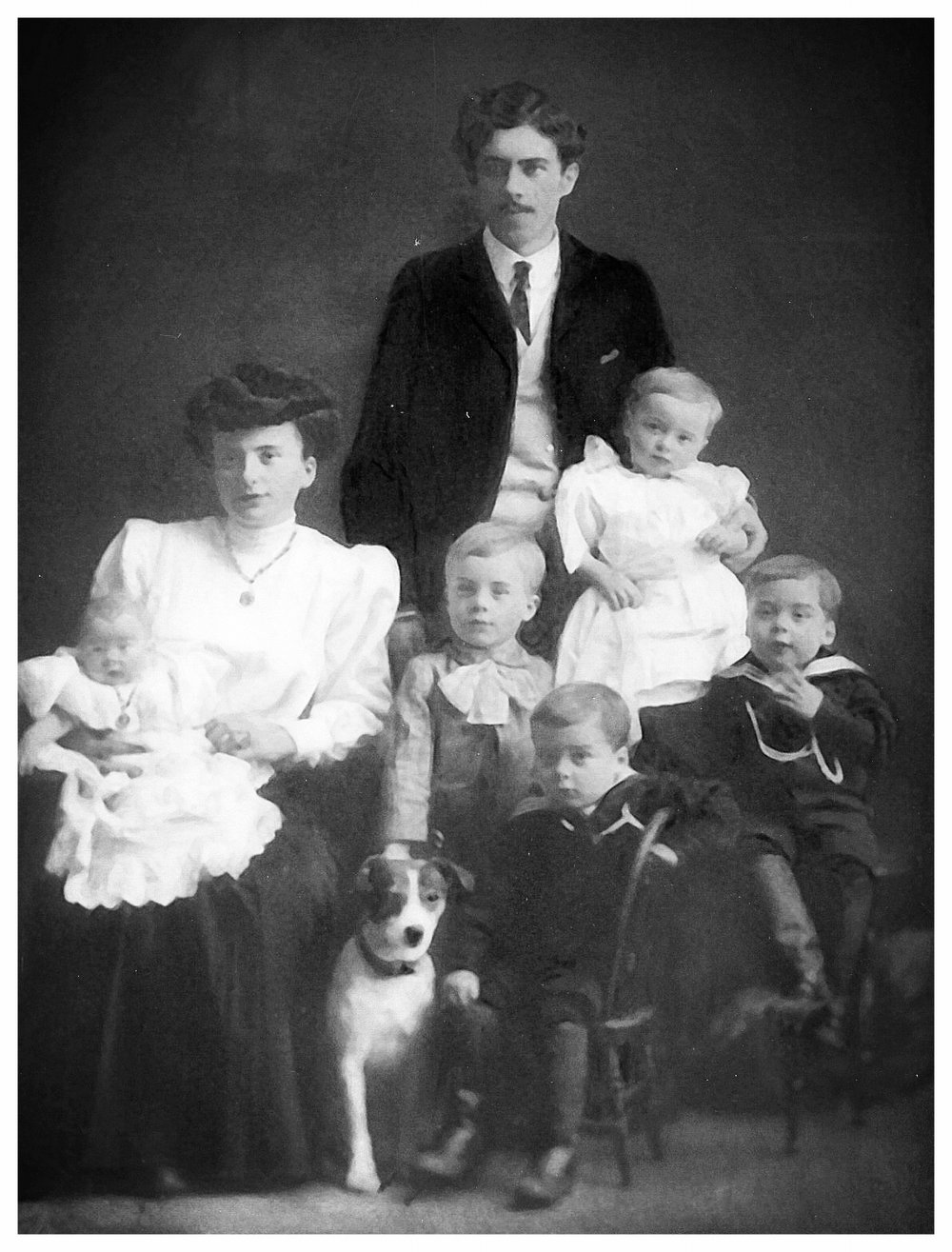 From Left to Right; Wally, Ada, George (Standing), Monte (Standing, middle), Dorothy, and the twins, Ernie (seated, middle front) Percy, and the family dog.