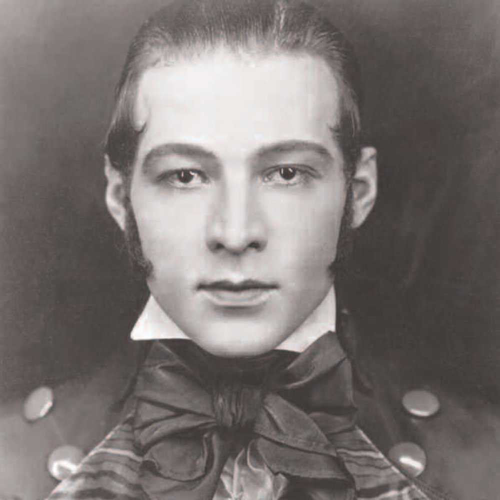 Monte washed Valentino's hair and applied a thin coat of Vaseline. He plucked and reshaped his eyebrows, defining the eye and making it appear larger. He contoured the jawline, lightened his deeply rouged lips and applied Vaseline to the lips for a bit of shine and fullness.