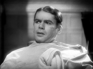 Actor, Paul Muni,  Scarface   (1932), seen here with his sinister scar created by Monte. This scar would become a trend in gangster films of the 1930's and beyond.