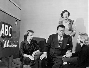 """Ern with his """"Girl Friday"""", Betty Westmore (standing)."""