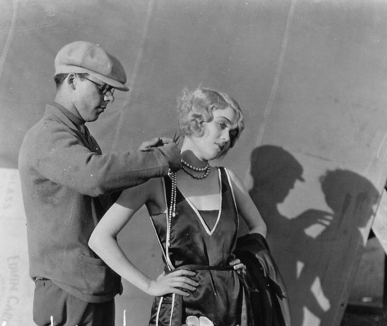 George perfecting a bob cut, with actress, Constance Bennett.
