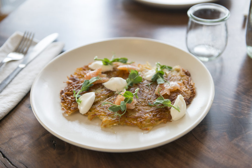 potato latke with cured Paradise valley trout, creme fraiche and pea shoots