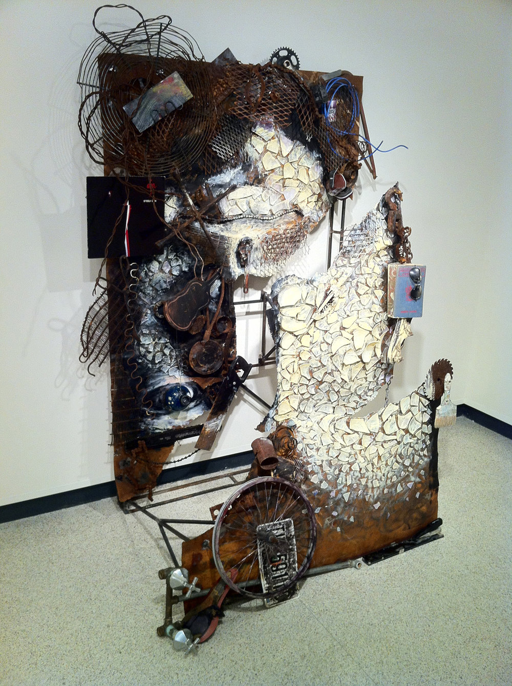 Esentially, (for what it's worth)   ~ Welded steel framework, found objects, blown glass, paint ~ 7x5x3.5ft ~ 2012