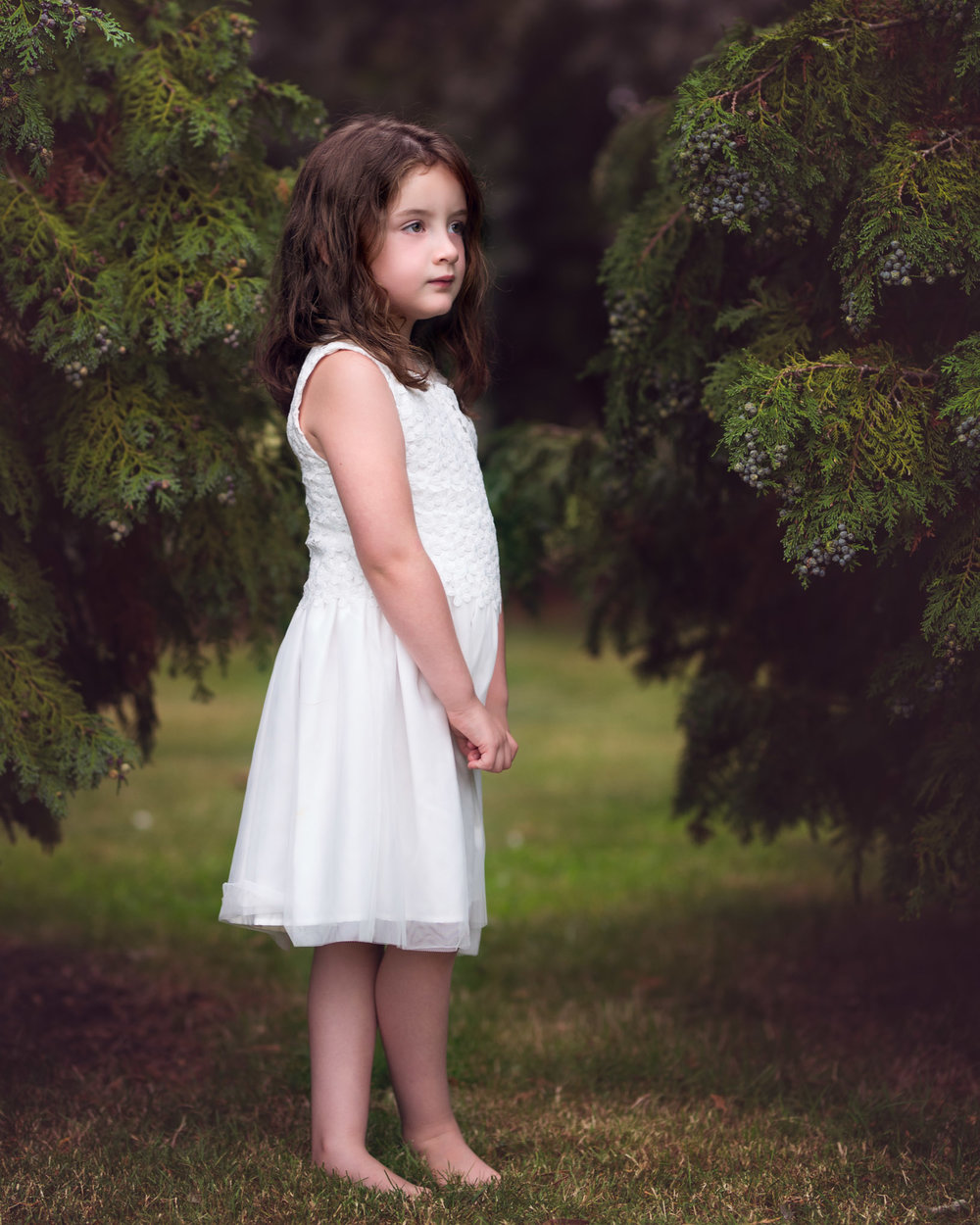 Girl between trees | Children's Photography