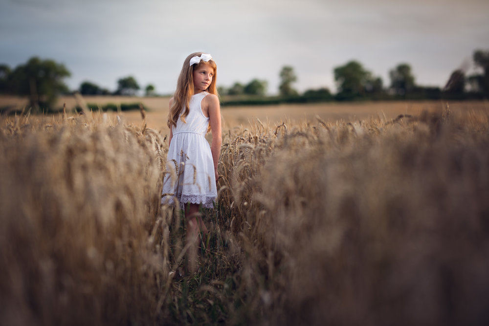 Girl in wheat field at golden hour | Children's Photography