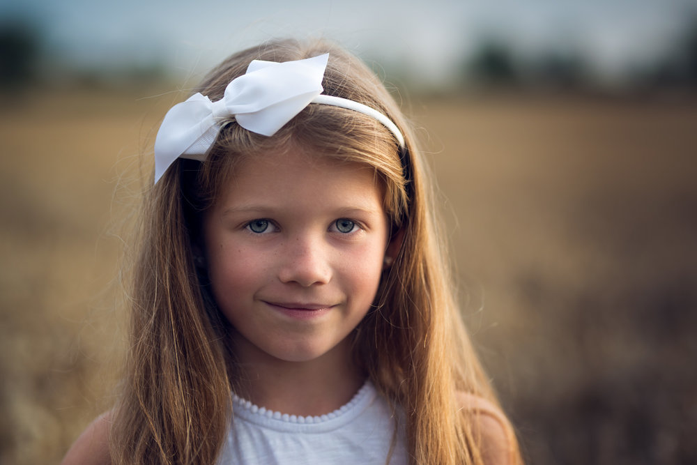 Young girl in wheat field headshot | Children's Photography
