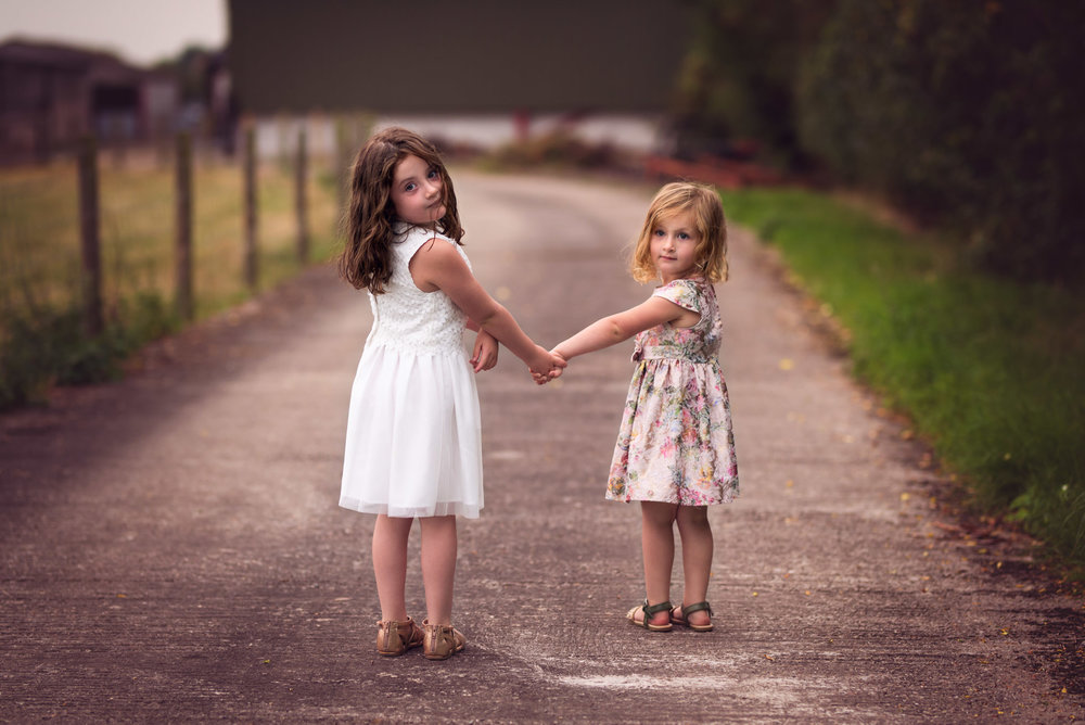 Sisters holding hands on the farm road | Children's Photography