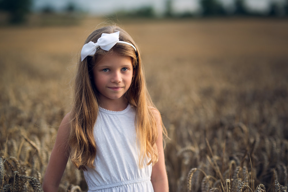 Golden hour portrait of girl in white dress | Children's Photography