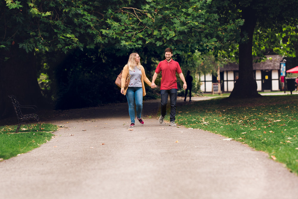 Engaged couple strolling in the park - Cotswolds Wedding Photographer
