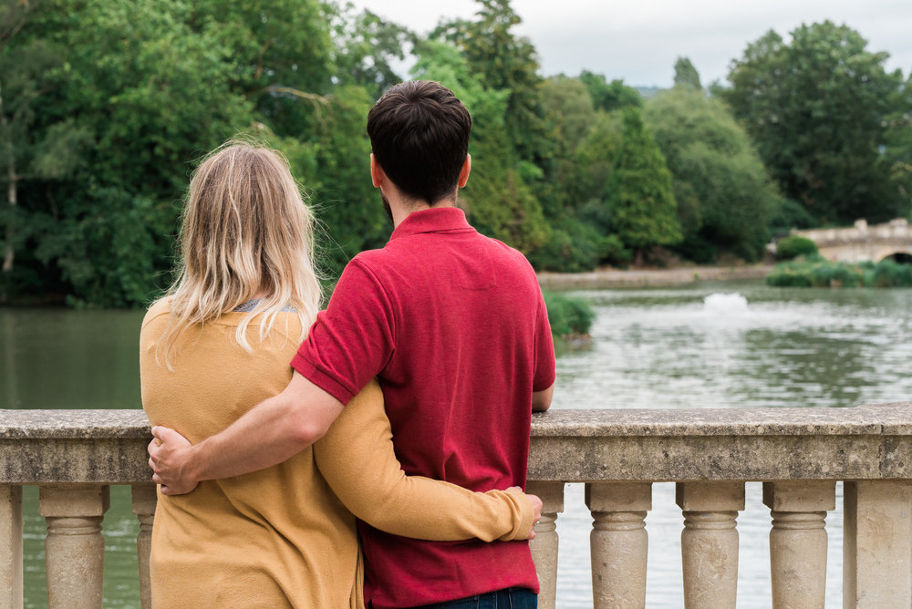 Couple looking out over the lake at Pittville Park - Cotswolds Wedding Photographer