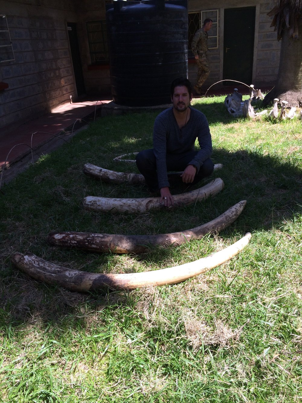 Me with Elephant Tusks recovered from poachers.JPG