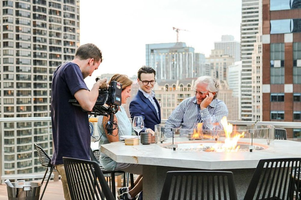Laurence Geller (far right) at Noyane, the rooftop restaurant at Conrad Chicago. Photo by Victoria Kent.